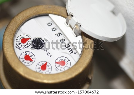 close up of water counter with display and red pointer - stock photo