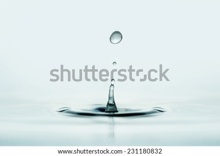 close up of water drop over wet surface - stock photo