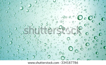 Close-up of water drops on glass surface as background - stock photo
