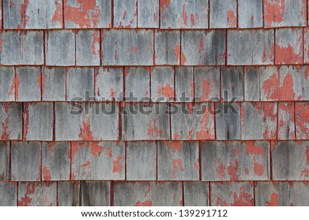 Close up of weathered cedar shingled side of home in Eastport, Maine, USA. - stock photo