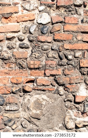 Close up of  weathered Dark and old stone wall - stock photo