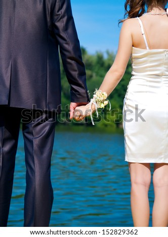 Close up of wedding couple with holding hands - stock photo