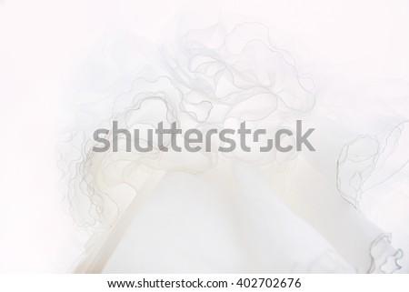 Close up of wedding dress hanging - stock photo