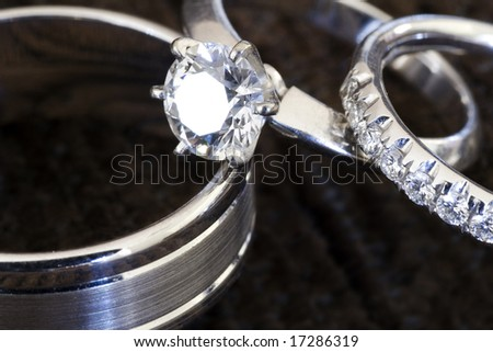 Close-Up Of Wedding Rings And Engagement Ring