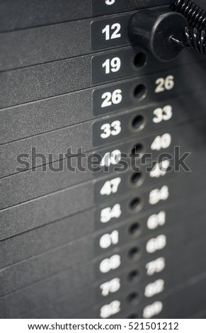 Close up of weight stack in gym