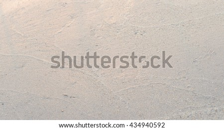 Close up of wet beach sand,  Sand background  - stock photo