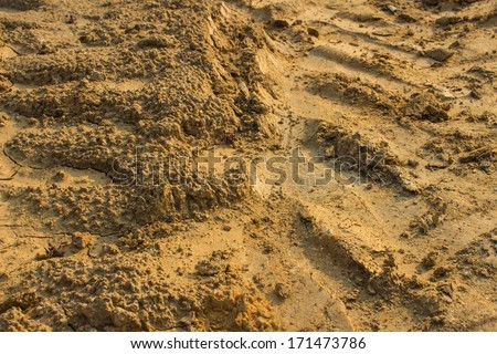 Close up of wheel tracks on the soil - stock photo