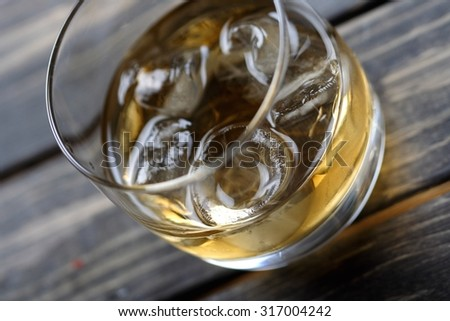 Close-up of whisky glass - stock photo