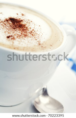 Close-up of white cup of coffee