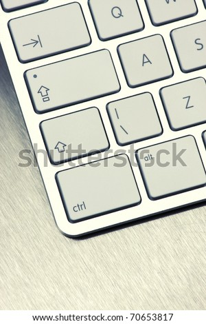 Close-up of White keyboard on metal background - stock photo