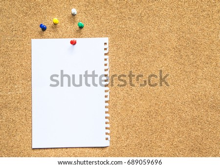 close up of white paper on  blank empty cork board texture background. can be used for your text background or copy space