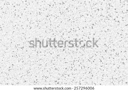 Close up of white pebble stones wall texture for background - stock photo