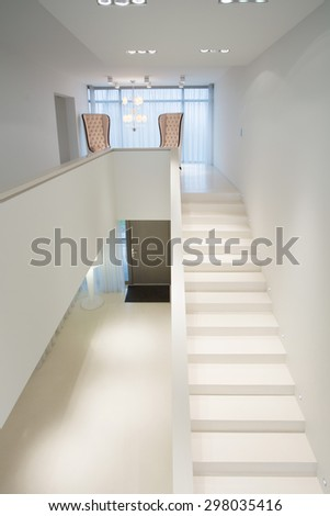 Close-up of white stairs in exclusive mansion - stock photo