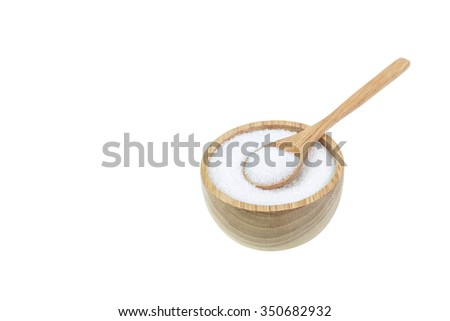 Close up of white sugar in wooden bowl isolated on white background - stock photo