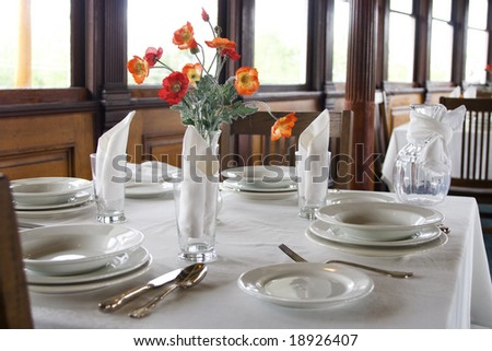Close up of white table setting in luxurious restaurant - stock photo