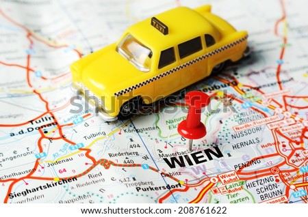 Close up of Wien , Austria  map with red pin and a taxi   - Travel concept - stock photo