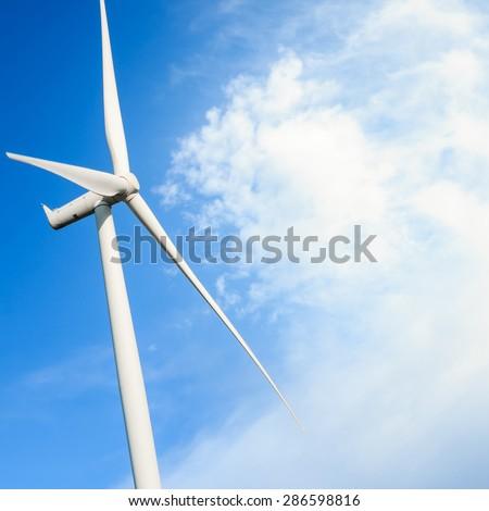 Close up of Wind turbine generating electricity, alternative energy - stock photo