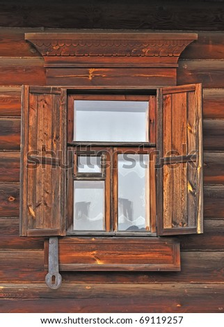 Close up of window with wooden shutter in russian country house - stock photo