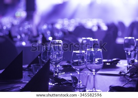 Close up of wine glasses prepared for guests - stock photo