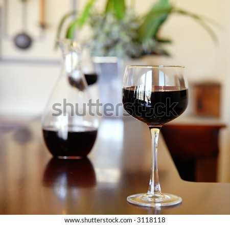 close-up of wineglass with copyspace and abstract lights - stock photo