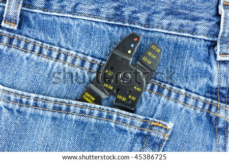 Close Up of Wire Stripper in Blue Jeans Pocket