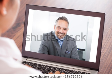 Close-up Of Woman Attending Video Conference On Laptop - stock photo