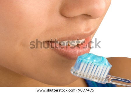 Close up of woman brushing her teeth - stock photo