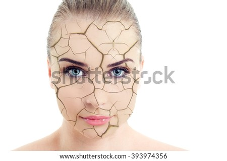 Close-up of woman cracked and damaged face as cosmetic and dehydration effect concept isolated on white background - stock photo