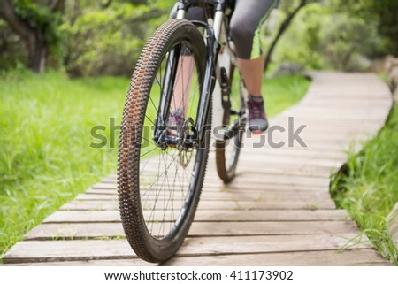 Close-up of woman cycling in the countryside