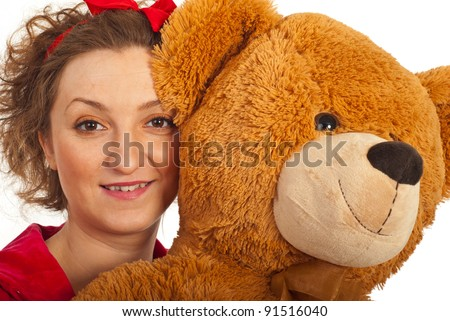 Close up of woman face holding big teddy bear against white background - stock photo