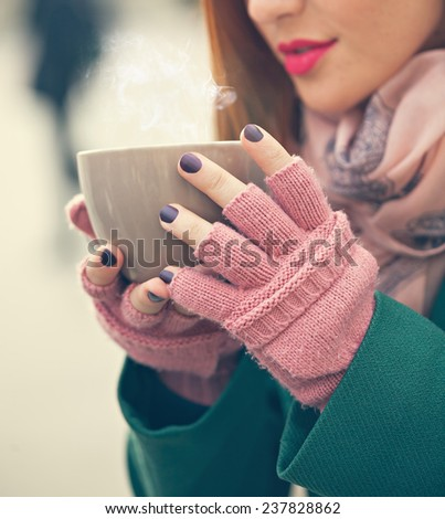 Close Up Of Woman Hands Holding A Cup Of Hot Beverage - stock photo