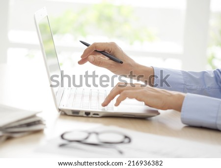 Close-up of woman hands on computer keyboard  - stock photo