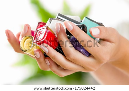 Close up of woman hands with nail polishes - stock photo