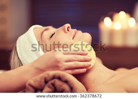 close up of woman having face cleaning in spa - stock photo