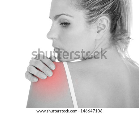 Close up of woman having shoulder pain isolated on white background - stock photo