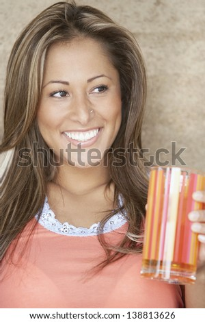 Close up of woman holding glass