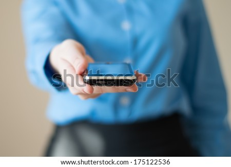 Close up of woman holds  mobile smart phone in hands