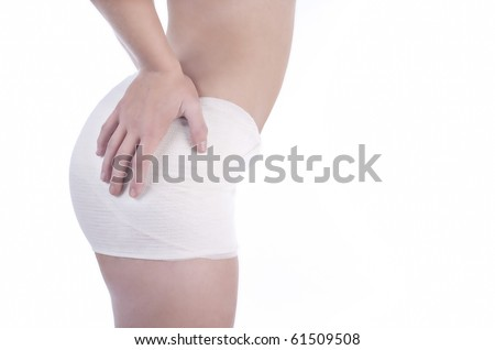 Close up of woman in bandages after buttocks plastic surgery
