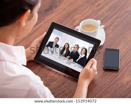 Close-up Of Woman Looking At Video Conference On Digital Tablet - stock photo