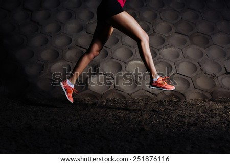 Close-up of woman running in urban scene - stock photo