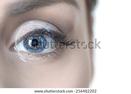 Close-up of woman's eye. New technologies concept - stock photo