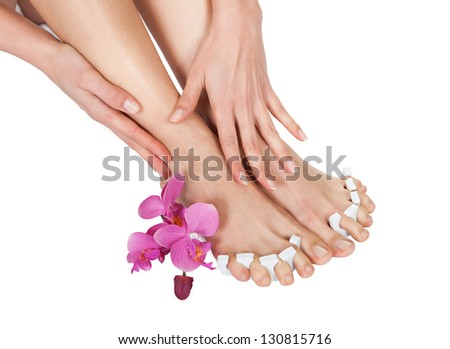Close-up Of Woman's Feet Getting Pedicure Treatment