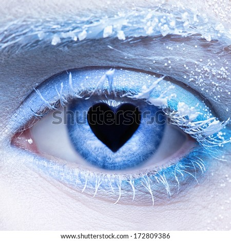 close-up  of woman's frozen style eye zone make up and pupil in for of heart - stock photo