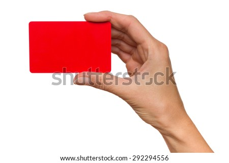Close up of woman's hand holding red card. Studio shot isolated on white. - stock photo