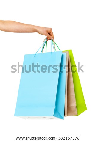 Close up of woman`s hand with shopping bags isolated on white background. Shopping concept.