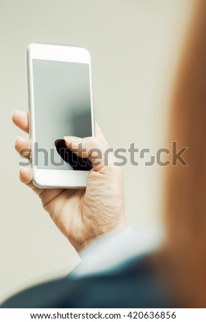Close-up of woman's hands with smart phone.