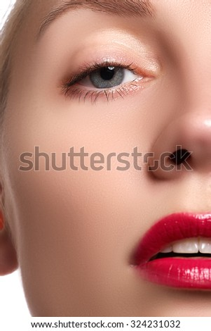 Close-up of woman's lips with bright fashion red glossy makeup. Macro bloody lipgloss make-up. Red sexy lips. Open mouth. Manicure and makeup. Make up concept. - stock photo