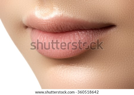 Close-up of woman's lips with fashion natural beige lipstick makeup. Perfect Lips. Sexy Girl Mouth close up. Beauty young woman Smile. Natural plump full Lip. Lips augmentation. Close up detail - stock photo