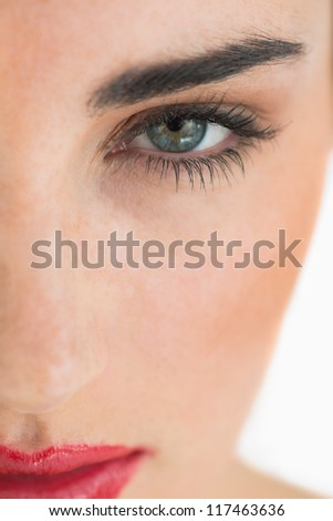 Close up of woman's made up face - stock photo