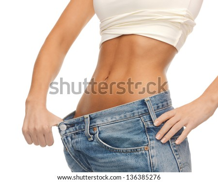 close up of woman showing big pants - stock photo